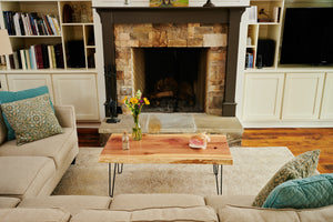 Raw edge coffee table in living room, handmade by Knaughty Log Co in the USA.