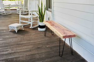 Outdoor wood slab bench with live edge, handmade by Knaughty Log Company in the USA.