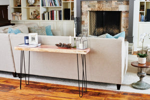 Living edge sofa or couch table in family living room, handmade by Knaughty Log Company.