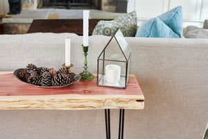 Edge of a live edge couch table in living room by Knaughty Log Co.