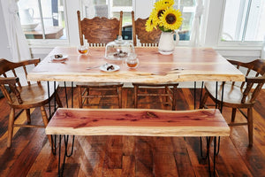 Beautiful live edge dining room table with a matching bench made of reclaimed eastern red cedar in the USA by Knaughty Log Co.