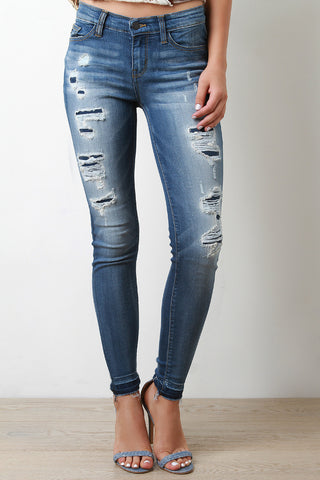 Mid Rise Undone Distressed Denim Jeans
