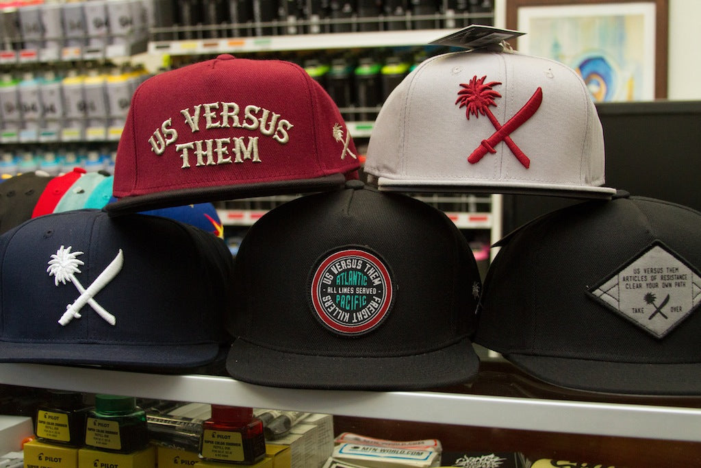 New Us Versus Them hats just hit the shop