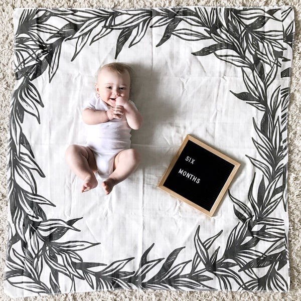 SLIGHTLY IMPERFECT- MUSLIN SWADDLE BLANKET - B+ W LEAVES FRAME - Dotboxed