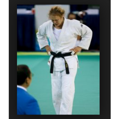 Ronda Rousey competing in Judo as a blackbelt in the Olympics with taped fingers or buddy tape