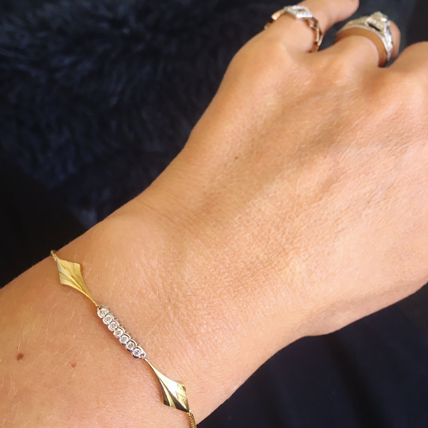 Hand image gold diamond bracelet