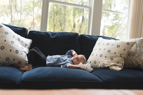 toddler laying on couch