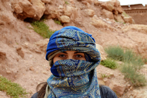 woman with scarf wrapped around her head like a hat