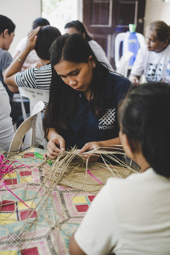 ic: Riza teaching kids how to weave at the Woven on the Move workshops in Manila