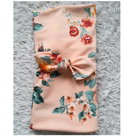 Peach floral swaddle set! Swaddle and bow are included in the set! Soft and stretchy!