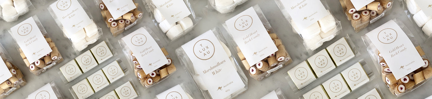 TLUXAU Luxury Food. White and Gold Label. Confectionery. Chocolates. Fudge. Nuts. Australian Made. Private Label. Customise To Your Corporate Brand