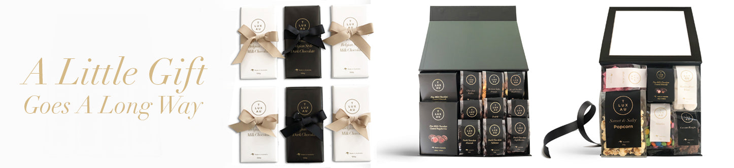 TLUXAU Specialise in luxury gifting. Black and white packaging. Chocolate Nuts and Confectionery. Corporate branding avaialable.