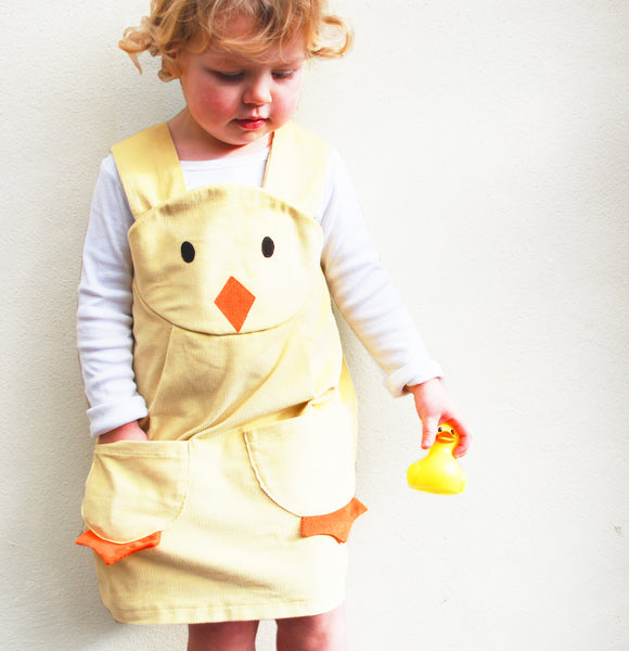 Chick character pinafore dress in yellow corduroy