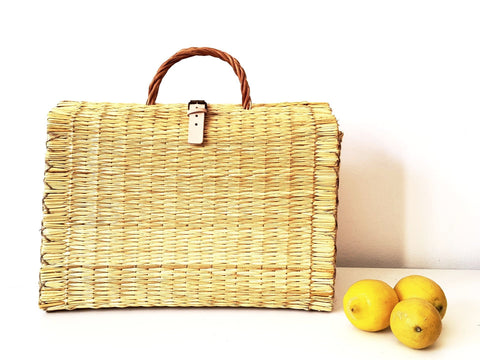 Natural reed artisanal handheld basket with leather closure