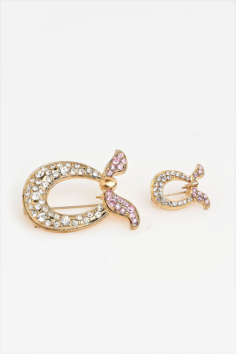 text -- brooch gold pink