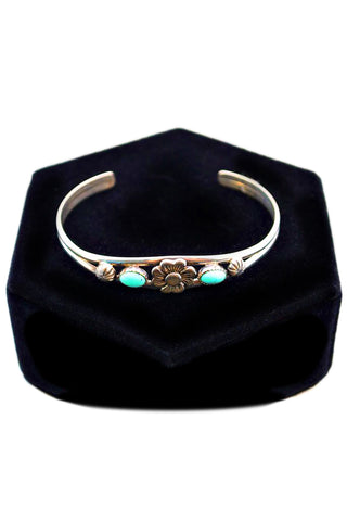 Silver bracelet with turquoise accents
