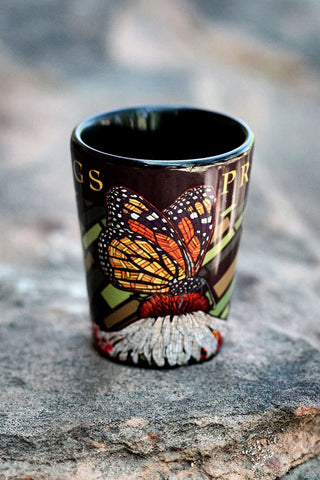 Shot glass with mosaic butterfly illustration