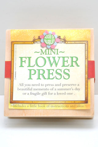 "Box that says ""Mini flower press"""