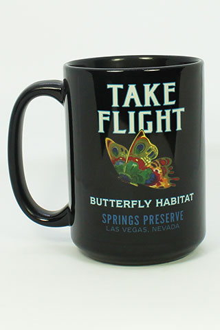 "Black mug with ""Take Flight Springs Preserve Butterfly Habitat"" on it, and butterfly design"