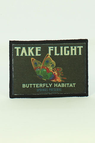 "Iron on patch with butterfly and ""Take Flight, Butterfly Habitat"" written on it"