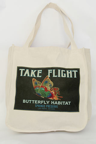 White tote bag with black take flight butterfly design