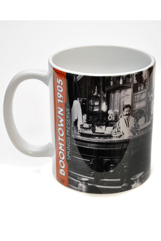 Mug with historic photo of man standing behind bar at Arizona Club.