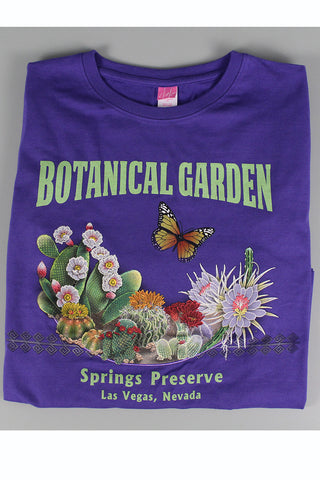 "Purple t-shirt with ""Botanical Garden Springs Preserve Las Vegas, Nevada"" text and butterfly/desert graphics."