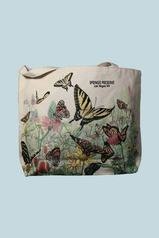 "Canvas tote bag with butterfly illustrations and ""Springs Preserve"" text"