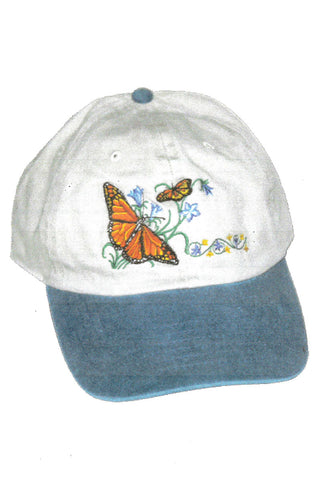 White hat with blue brim and butterfly embroidered on front.