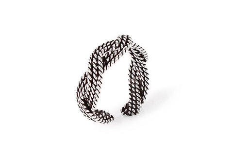 Braided silver knuckle ring