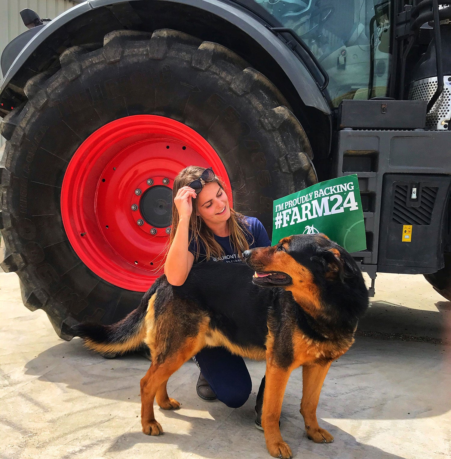 Emma dog next to tractor