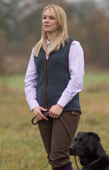 country woman with dog wearing Alan Paine Alysham Ladies Fleece Waistcoat