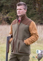 out in the field wearing Berwick Men's Waterproof Waistcoat by Alan Paine