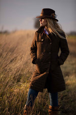 Quilted mid length coat by Alan paine worn by lady in field