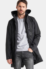 Man's Black Parka with grey sweat top and black jeans