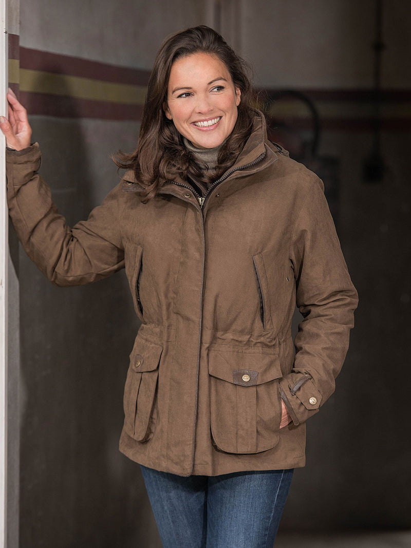 Chocolate Ascot Ladies Waterproof Jacket by Baleno  in a stable