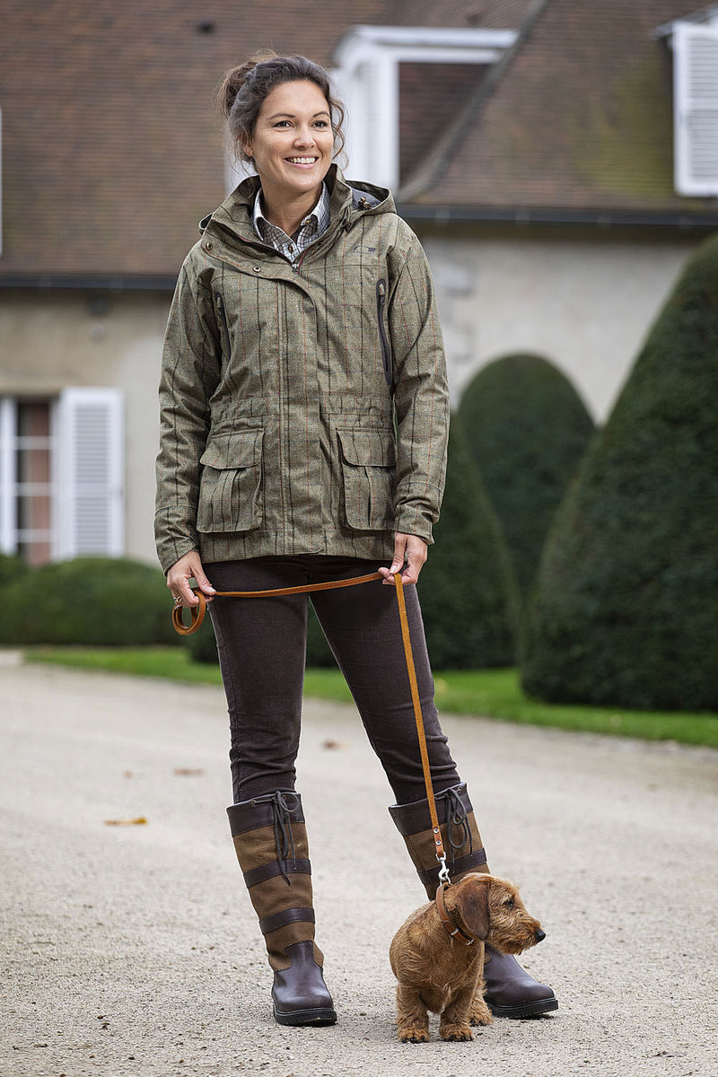 Lady wearing Baleno Pembroke Waterproof Jacket wlaking dog