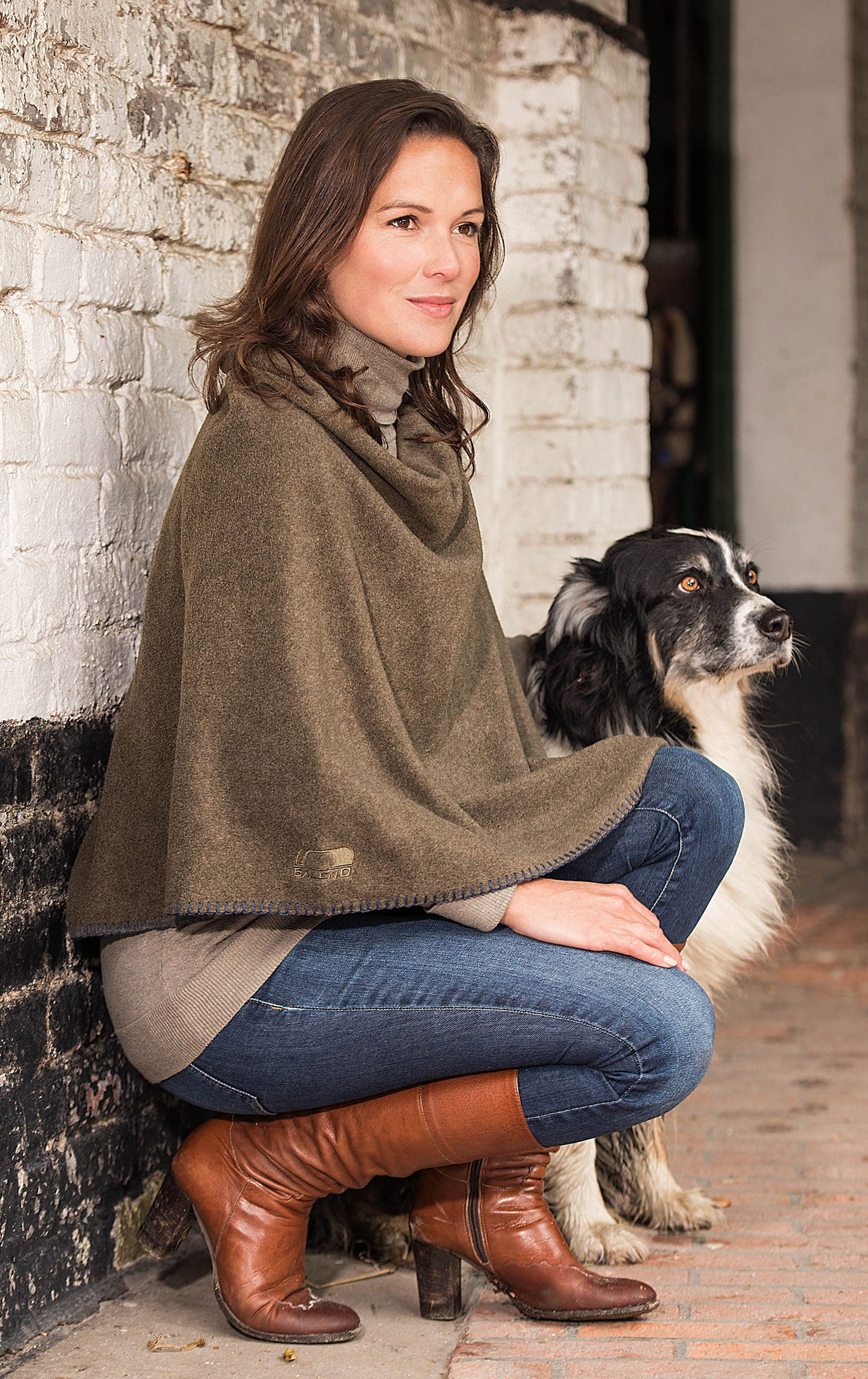 A classically styled lightweight marled poncho in three beautiful colours
