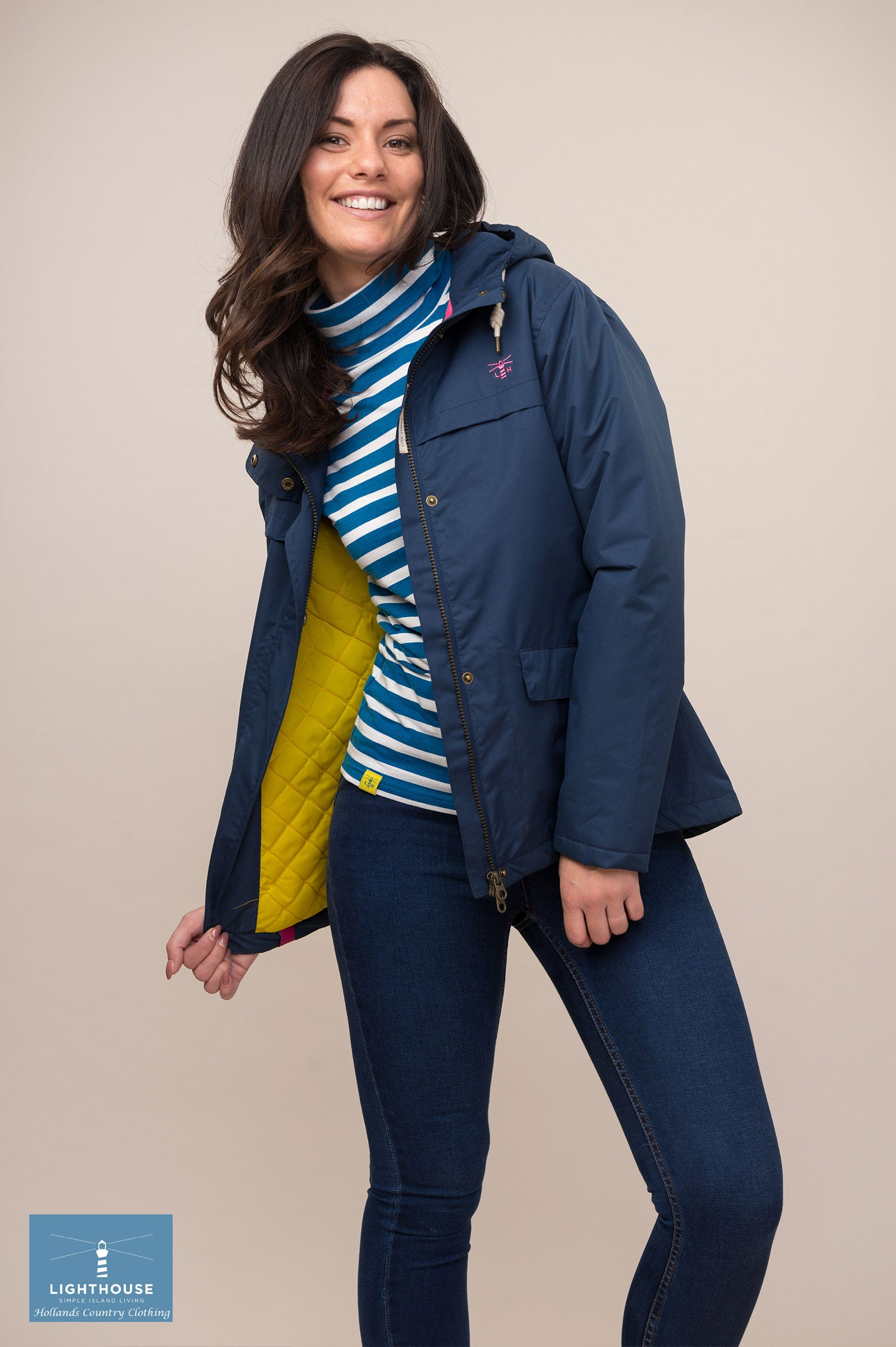 open in navy showing yellow lining Lighthouse Beaufort Waterproot Jacket in yellow, navy and berry