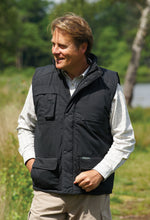 man wearing Champion Peak Multi-Pocket Padded Body warmer