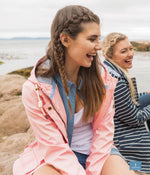 chatting with friends Lighthouse Bowline Rubberised Jacket in Pink, Navy and Yellow