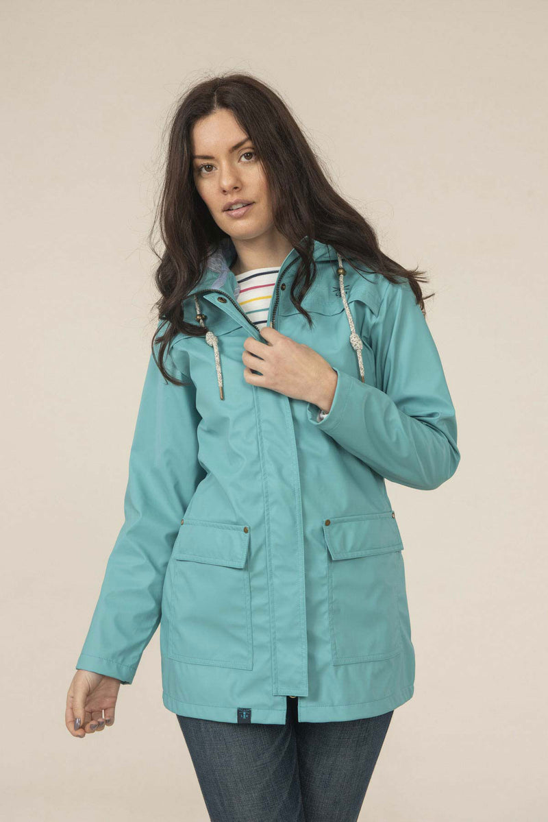 woamn wears Lighthouse Bowline Rubberised Jacket SS19 in soft teal