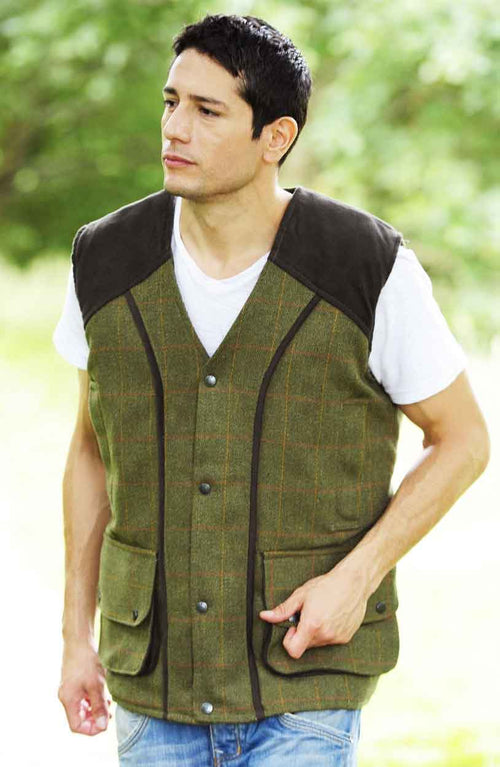 Bronte Tweed Waistcoat in dark green worn by a man