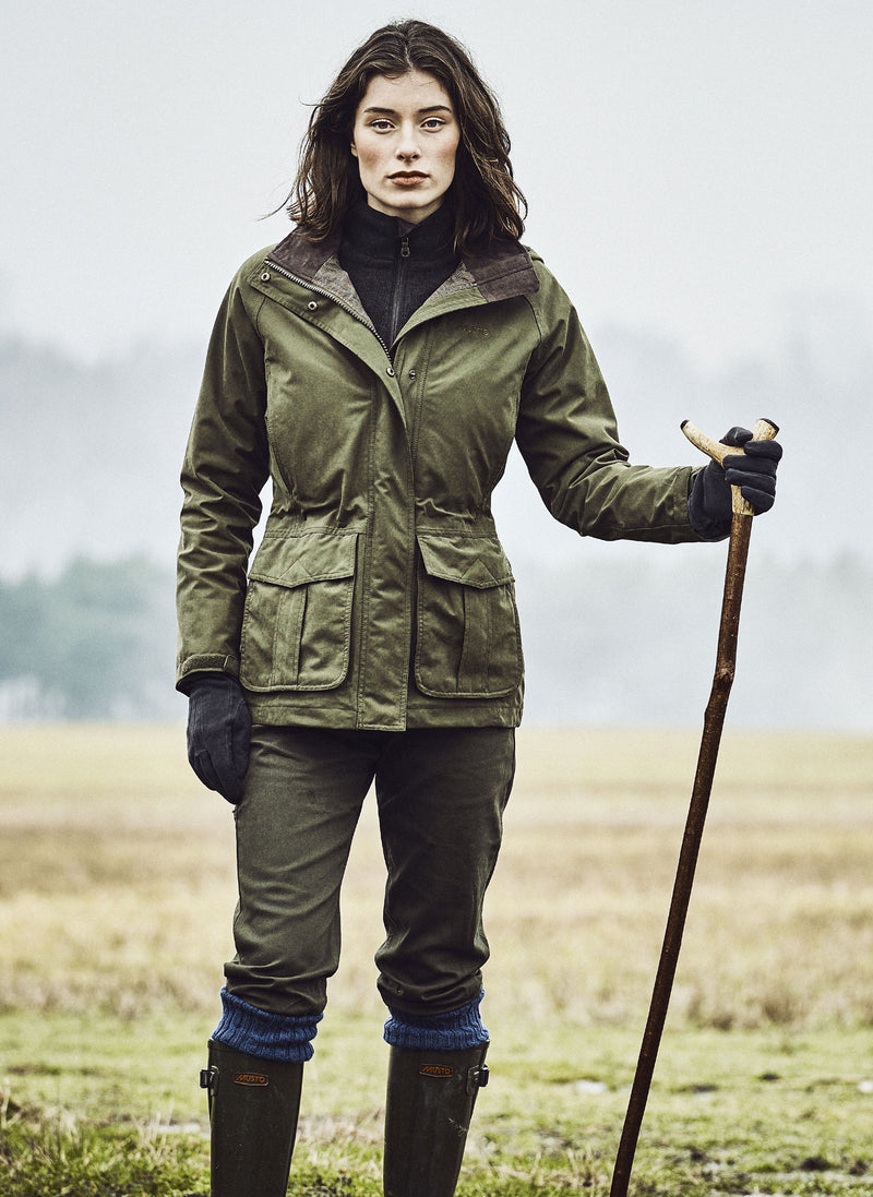 Woman wears Burnham Waterproof Jacket by Musto