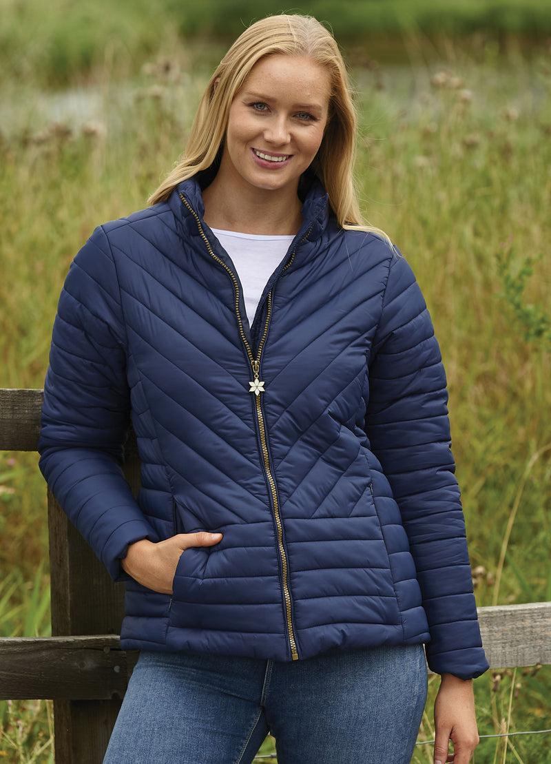 Woman wearing Navy Champion Frimley Baffle Quilted Jacket
