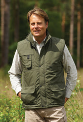 man wearing green Champion Peak Multi-Pocket Padded Body warmer