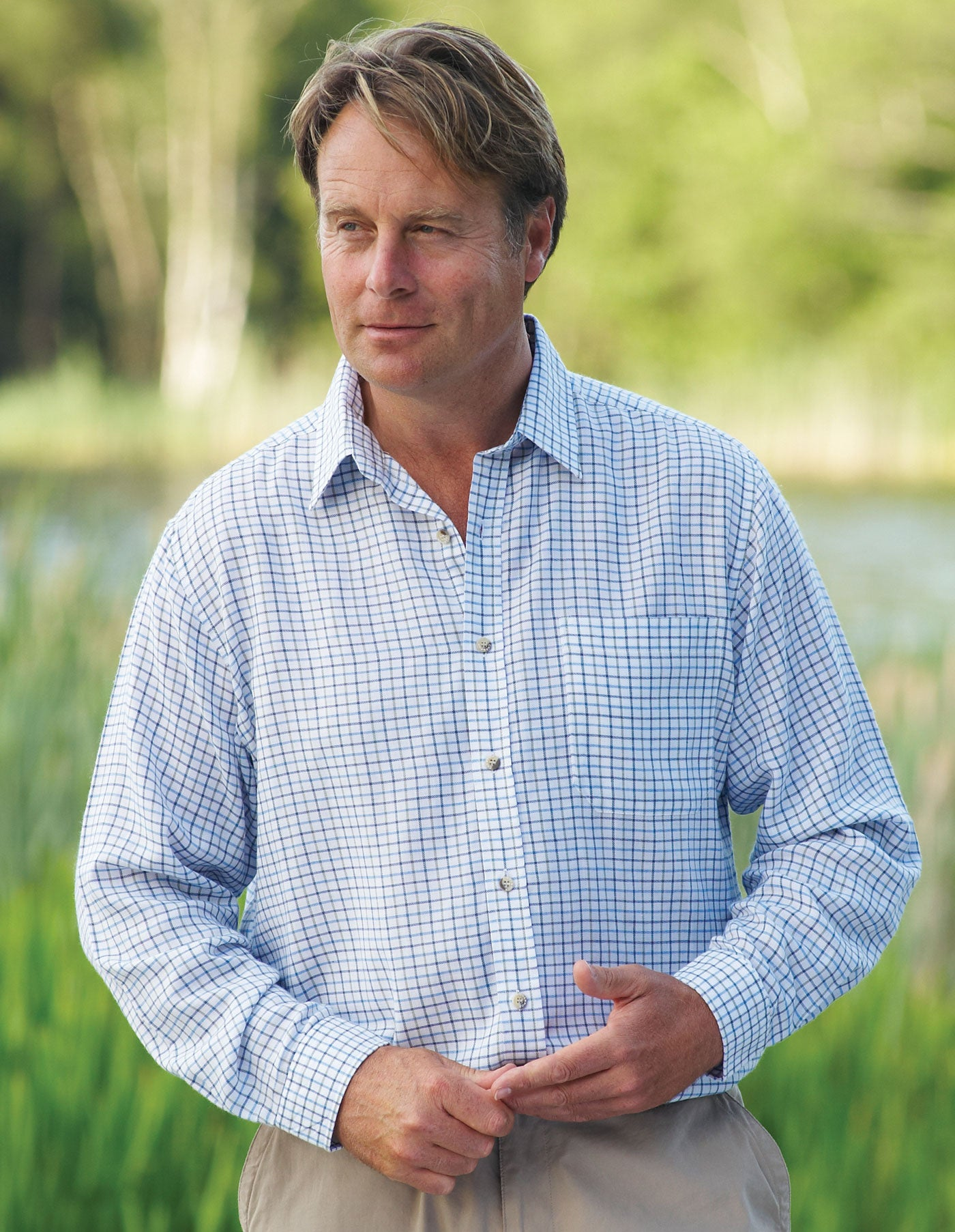 man in blue farmer's country tattersall long sleev shirt