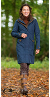 woman wears Chelsea 3/4 Length Waterproof Breathable Coat by Baleno navy