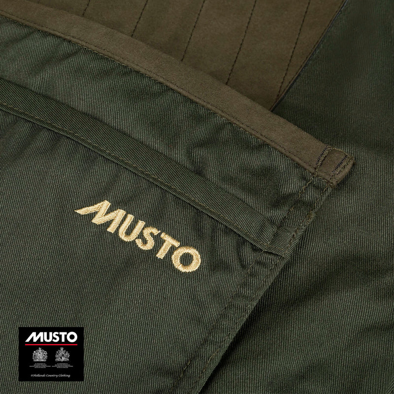 Gold Musto Logo on Green