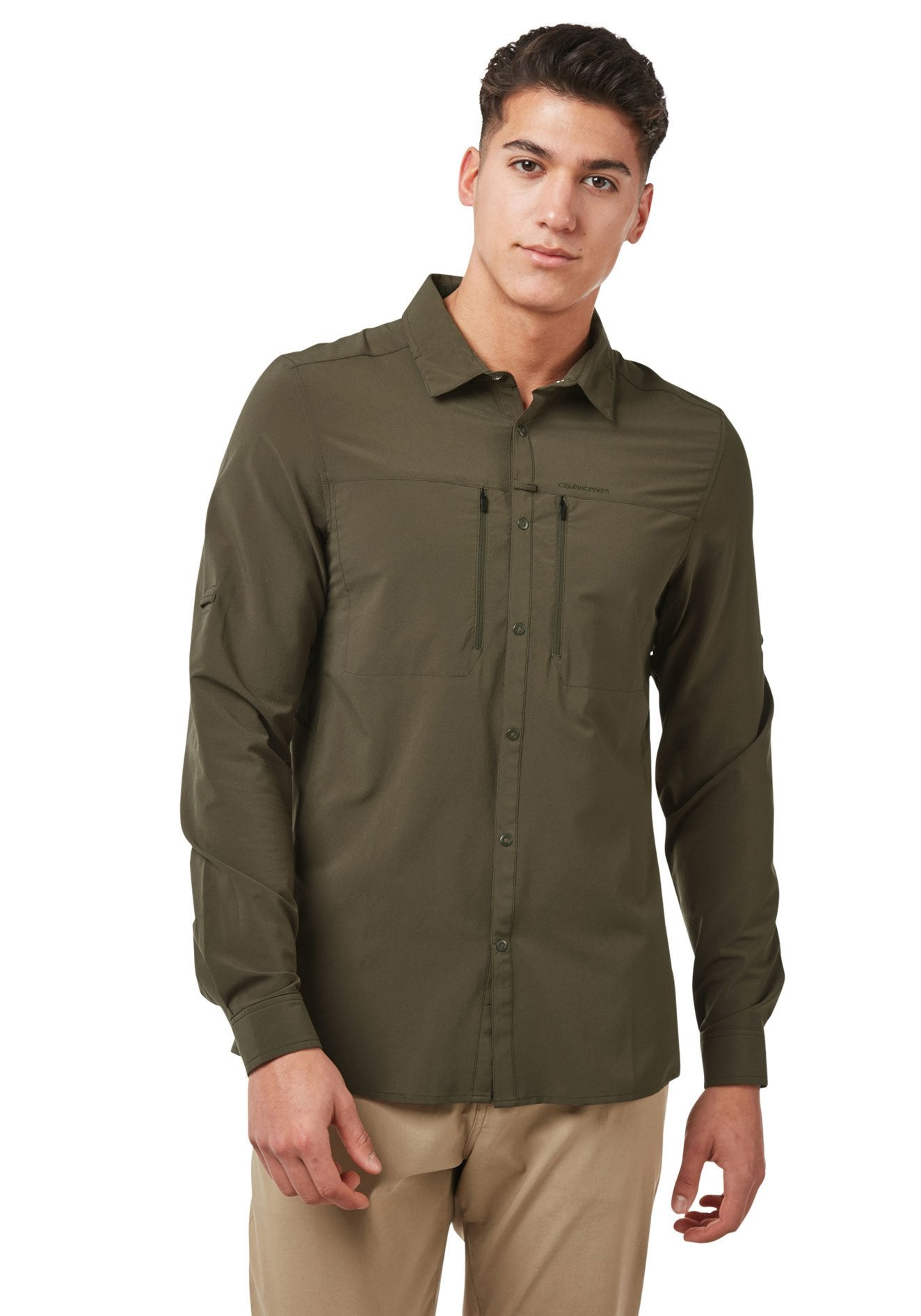 Man wears NosiLife PRO IV Long Sleeved Shirt by Craghoppers